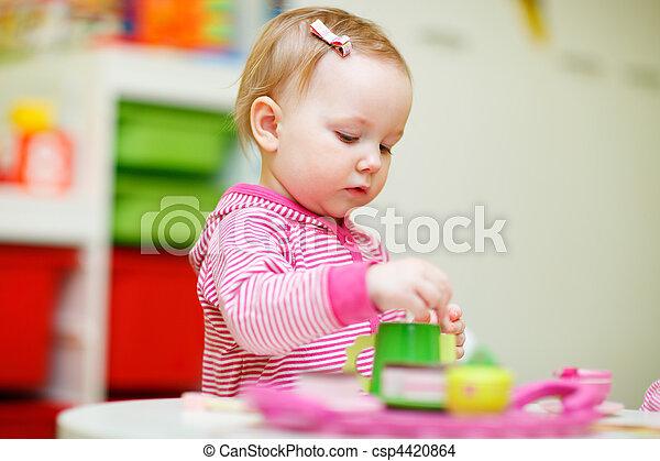 Toddler girl playing with toys - csp4420864