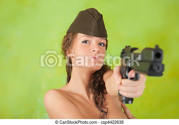 Topless  girl  aiming a gun  - csp4422638