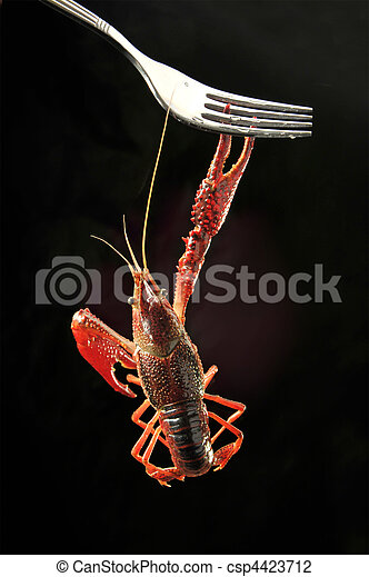small lobsters With fork on the Black background