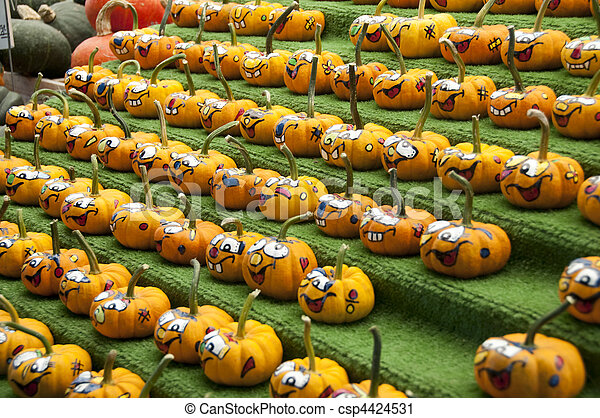 Rows of comical painted gourds - csp4424531