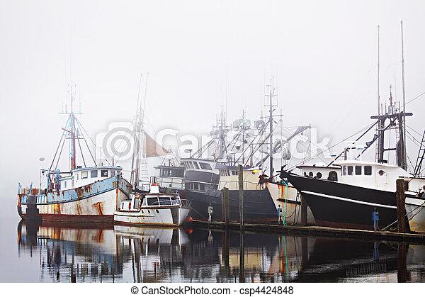 fishing boats in harbor fog - csp4424848