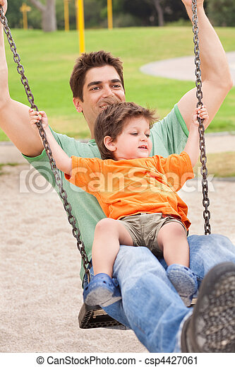 Father enjoying swing ride with his son - csp4427061