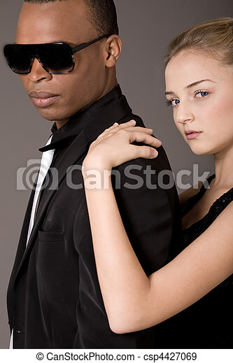 Portrait of young beautiful couple, black man and white woman - csp4427069