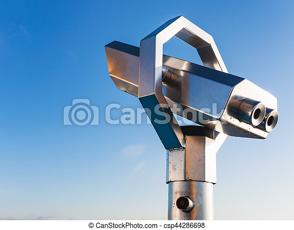 stationary observation binoculars and blue sky in sunny day