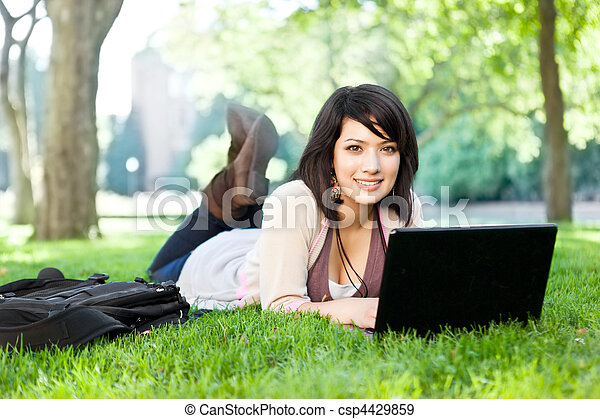 Mixed race college student with laptop - csp4429859