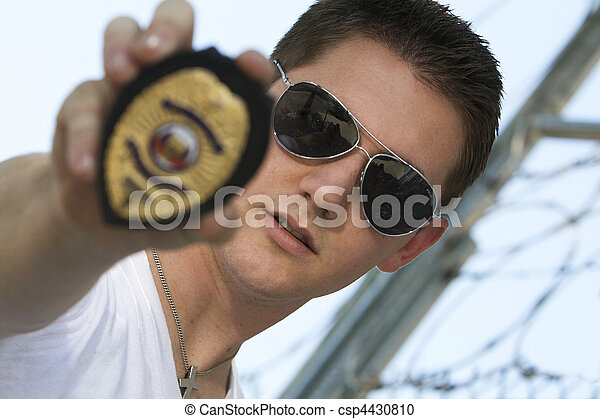 Stock Photography of Undercover officer with badge - Male ...