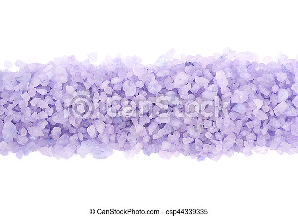 Pile line of salt crystals isolated over the white background, close-up crop framgent
