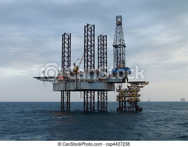 Helicopter and oil rig - csp4437238