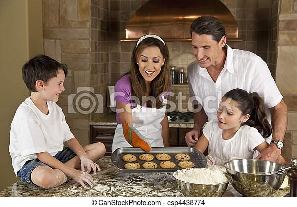 Attractive Family Baking and Eating Cookies In A Kitchen - csp4438774