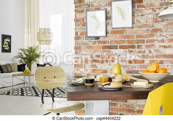 Industrial style dining room with wood table and chair
