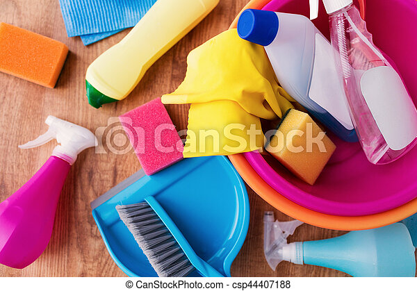 housework, housekeeping and household concept - basin with cleaning stuff on wooden floor