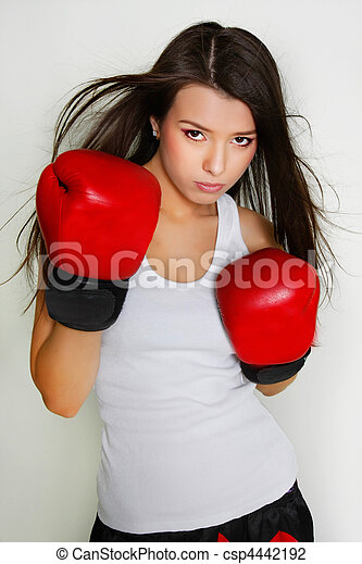 studio shot of beautiful female boxer - csp4442192