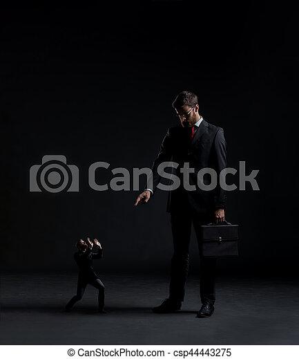 Boss punishing worker ovr black background. Businessman and subordinate.