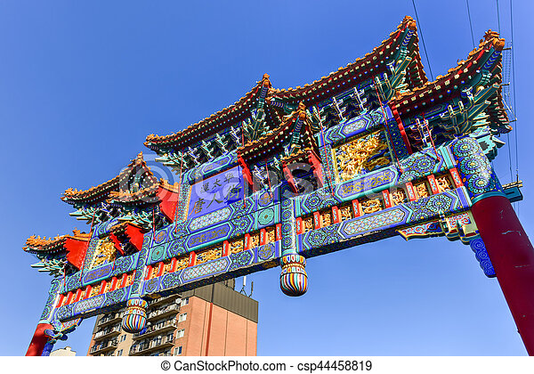 The royal imperial arch in Ottawa, Canada. It marks the entrance of the Chinatown area in Ottawa. Rich in symbolism, the center blue panel on the arch is Chinese characters saying \