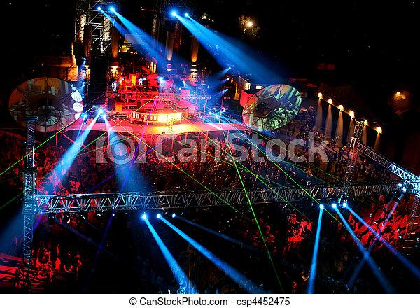 dancing people at night outdoor concert - csp4452475