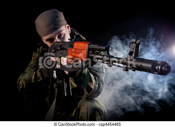 Young soldier in uniform with rifle - csp4454465