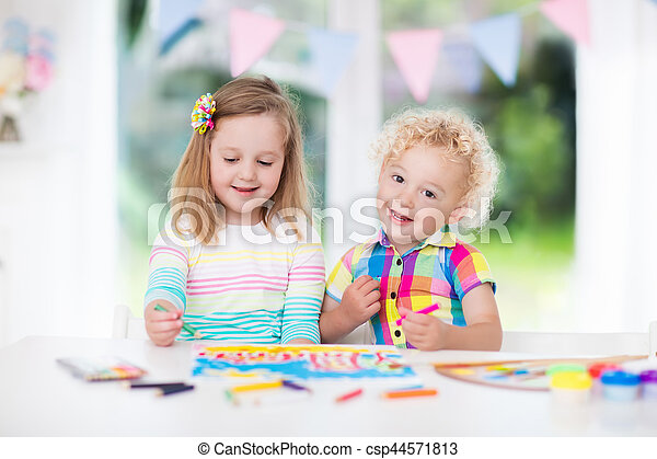 Little boy and girl draw together in white room with window. Kids doing homework, painting and drawing. Children paint with paintbrush color and pencils. Art and crafts for toddler and preschooler.