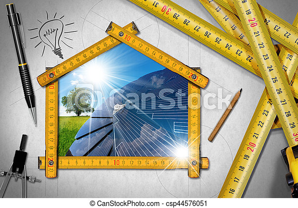 House project concept. Meter ruler in the shape of house with symbol of a family, pencil, drawing compass and a group of tape measures
