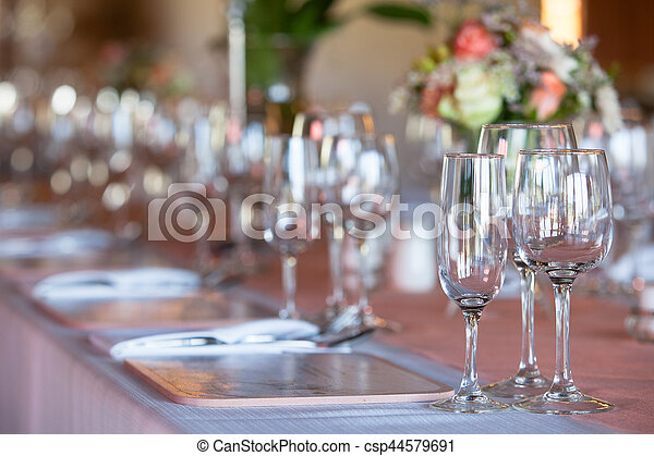 Champagne and wine glasses on decorated table at wedding reception - csp44579691