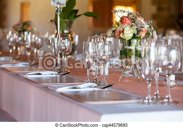 Table decorated with flowers at wedding reception - csp44579693