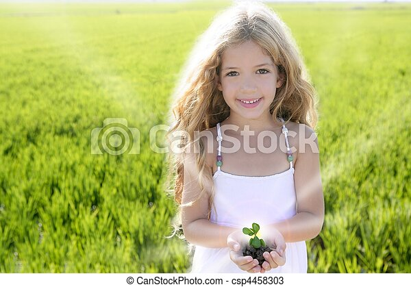 sprout plant growing from little girl hands outdoo - csp4458303