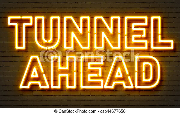 Tunnel ahead neon sign on brick wall background. - csp44677656