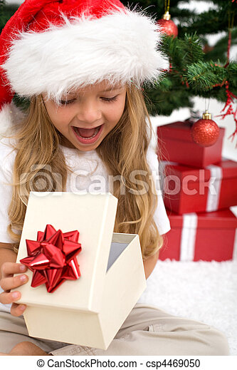 Excited little girl opening christmas present - csp4469050