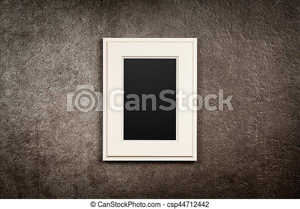 Picture frame on dark background.