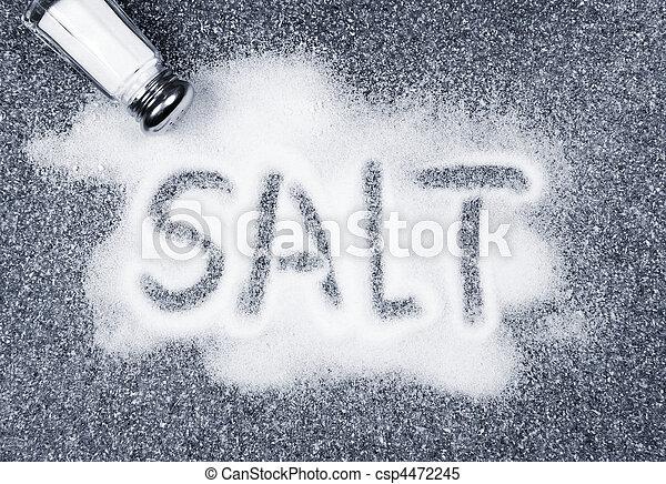 Salt spilled from shaker - csp4472245