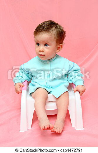 pretty baby sitting on chamber-pot - csp4472791