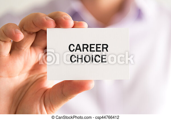 Closeup on businessman holding a card with text CAREER CHOICE, business concept image with soft focus background