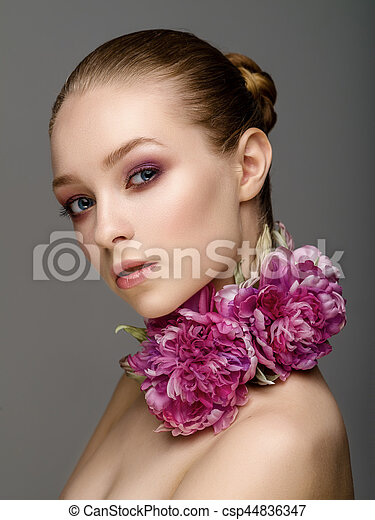 Beautiful girl with colorful bright makeup, flowers. Beauty face.