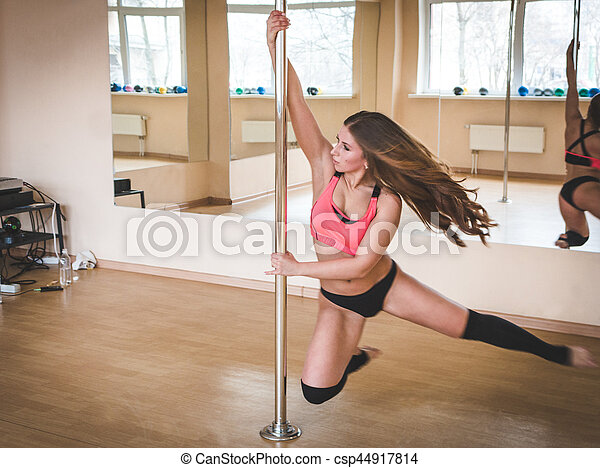 Pole dancer. a girl posing near pylon