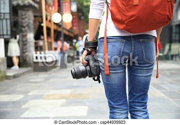 young woman tourist with camera on street in chengdu,china - csp44939923