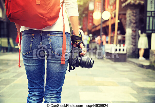 young woman tourist with camera on street in chengdu,china - csp44939924