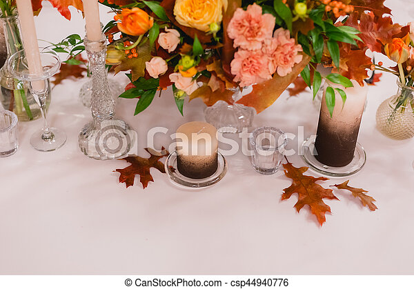 Wedding decoration of fresh flowers and candles on the table