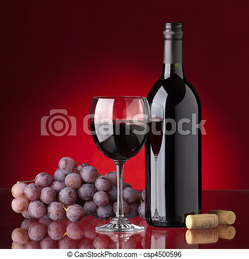 Bottle and glass of red wine - csp4500596