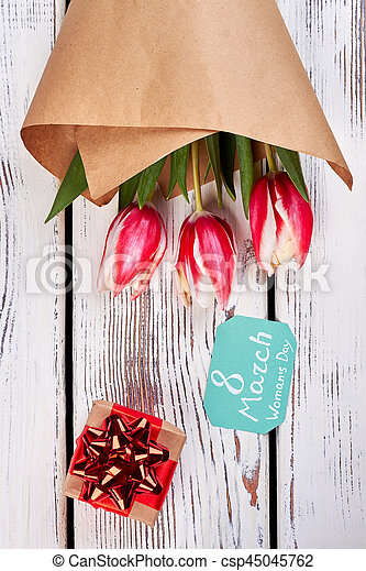 Gift box and flowers. Congratulation to Women\'s day.