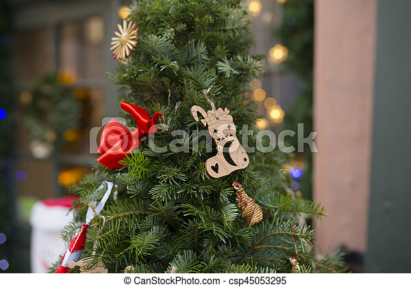 Street Christmas tree decoration near the restaurant. Lviv, Ukraine