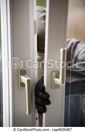 Burglar at a window - csp4505487