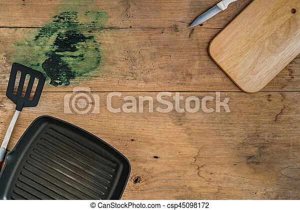 Top view of Kitchen ware utensils on wooden desk