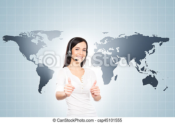 Operator working in a call center office. Customer support and a global business concept. Worldwide map background.