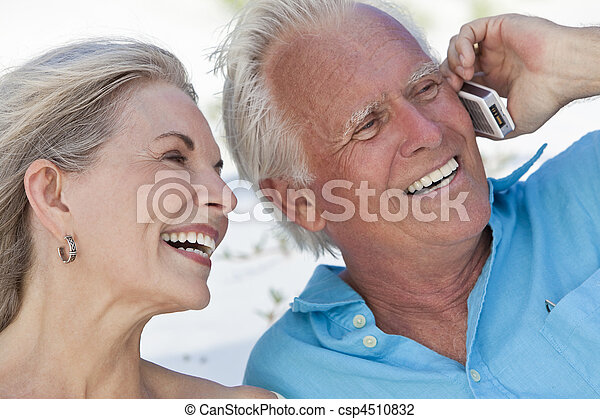 Happy Senior Couple Talking on Mobile Cell Phone - csp4510832