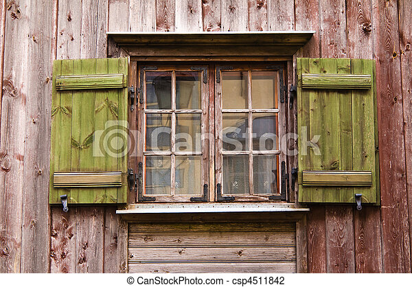 Old wooden window with shutters - csp4511842