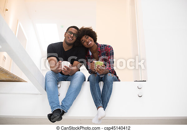 couple having break during moving to new house - csp45140412