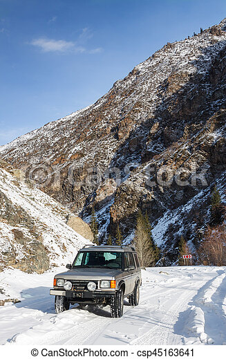 Sport Utility Vehicle on a snowy mountain road