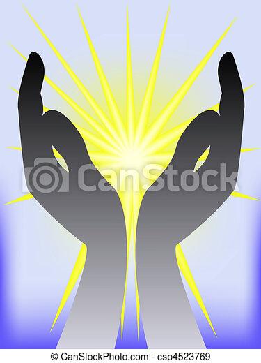 gold glow in  hands - csp4523769