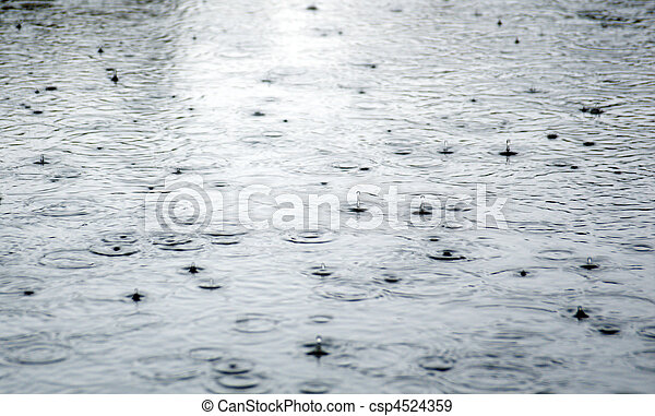 Rain drops rippling in a puddle . - csp4524359