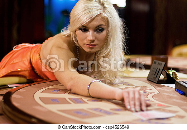 young women in casino takes playing cards - csp4526549