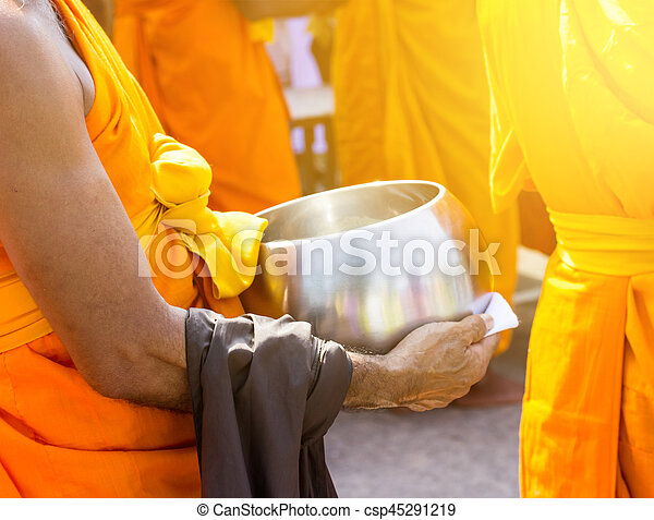 Offer food to monk on early morning.yellow tone